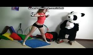Sporty attractive youngster pounds with funny Panda