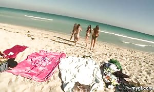 sexy babes are having fun on the beach