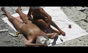 Now girl-friend stroke his penis him and helped jizz on the beach