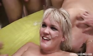 blonde is gulping mouth-watering lots of horny jizz in the gang bang video clip