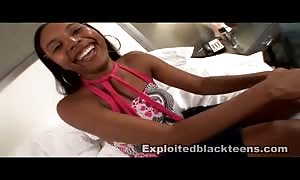 innocent black youngster is demonstrating her stunning oral abilities