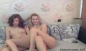 Two playful huge-boobed Russian cuties are posing totally disrobing in the slave trainer master bedroom