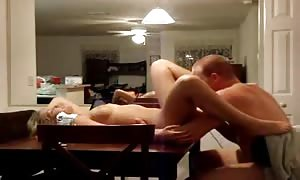 banging his wife on the devouring condominium table